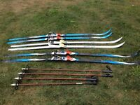 Three Sets of Skis (Wax Less) and two sets of poles