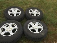 4 coopers discoverer A/T tires and rims 225/75R16 m+s