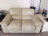 Cream two-seater leather sofa x2 £50 each