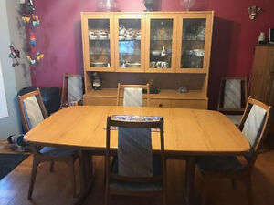 Wood Dining Table and Hutch for sale.