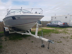 1985 21 footer Tempest Cuddy Cabin Boat and tamdem axeltrailer