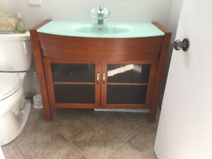 2 Bathroom vanity's with glass sinks and taps