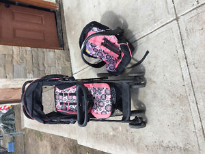 Stroller with matching car seat and base for little girl.