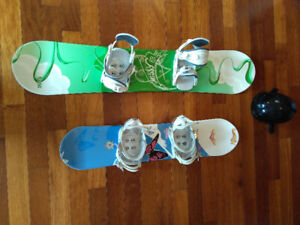 Two kids (girls) snowboards with bindings and a helmet