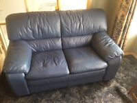 2 X two seater blue leather settees and pouffe