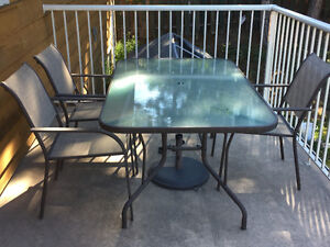 Large tempered glass table with 4 sling chairs etc