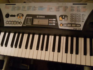 Yamaha Electric keyboard with stand and bench
