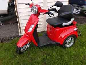 REDUCED -- NEW -- Three wheel electric scooter