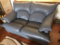 Two seater sofa and two matching armchairs
