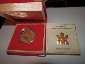 An encased 2003 LUNAR SILVER CAN.COIN (year of the sheep)
