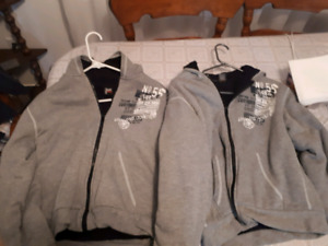 Pair of ladies sweat sweaters zips up in front size large$25 fo2