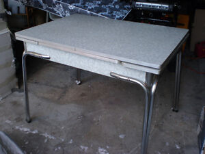1950's RETRO KITCHEN TABLE  WITH 2 PULLOUTS $40 OR TRADE METAL