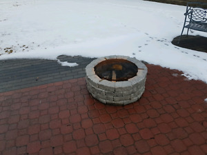 Stone fire pit with grate