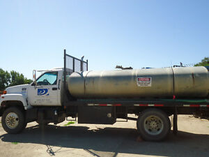GMC C7500 series truck with water tank
