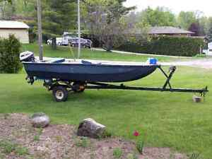 Fishing boat, gas tank, seats, motor and a trailer