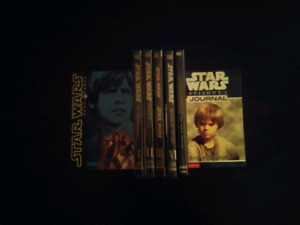 Star Wars package. 5 DVD's and 2 books.