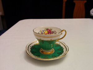 ORNATE GREEN AND GOLD CUP AND SAUCER