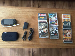 PSP (Gen. 1) with charging cords, 6 games, and 2 movies