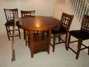 counter height table and6 chairs plus a leaf