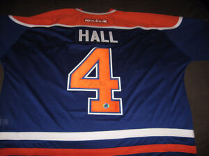 TAYLOR HALL AUTOGRAPHED BLUE  JERSEY w/COA NEW AND NEVER WORN