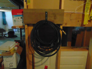 """1"""" inch black used 50 ft. in length hose in good condition"""