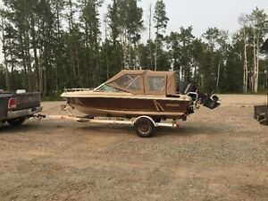 Must Sell1983 Invader w/ 1986 150 HP outboard motor and trailer