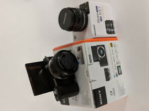 SONY a5000 mirrorless W/ 35mm f1.7 lens and 16-50 kit kens combo