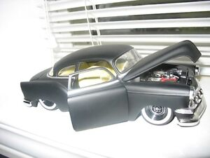 FOUR DIECAST  CARS COLLECTIBLES