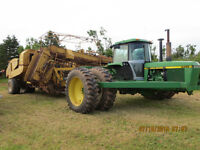 4455 John Deere Tractor mounted in an 873 LL 4 row harvester