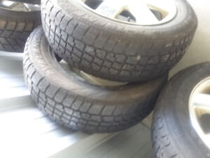 4 + 1  Snow tires for sale on Lincoln rims