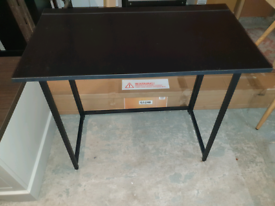 A new stylish black wooden compact folding computer table .