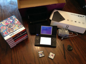 Black Nintendo DSI with games