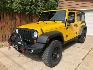 2008 Jeep Wrangler Unlimited , 2 Tops, 2 sets Wheels, & more