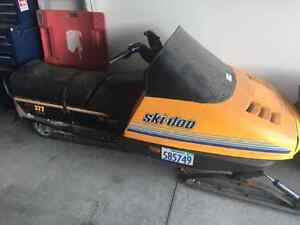 300 enticer and 377 skidoo safari