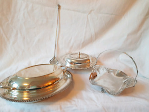 Multiple silver plate serving dishes and spoon