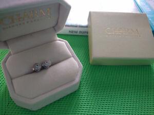 .25 carot Diamond earrings.  Asking 100.OBO
