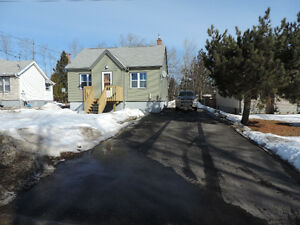 Updated home, large lot backing greenspace, close to Boulevard.