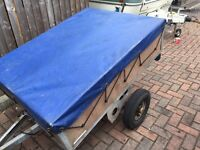 Car trailer with 2 new tyres and a full cover