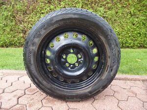 4 pneus d'hiver grandeur 225/55/ R17  sur roue + enjoliveurs