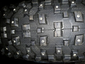 For sale a snowshoe 26x4.8 studded fat bike tire.