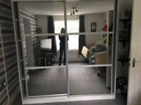Large wardrobe with mirrored sliding doors