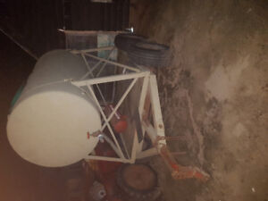 Water tank with trailer