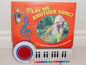PLAY ME ANOTHER SONG! PLAY SONGS  ON ELECTRONIC BOARD BOOK PIANO