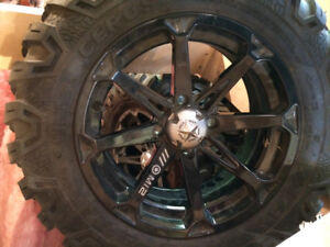Set of 4 quad tires on rims