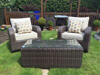 Top of the range rattan chairs and coffee table