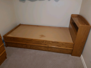 Solid oak twin bed frame and tall dresser
