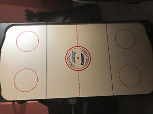 Air hockey board. 60 in by 30 in