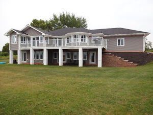 Beautiful custom home on a stunning 30 acre waterfront lot!