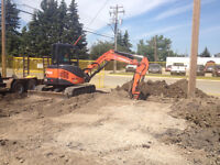 Decked out landscape mini excavator and operator for hire
