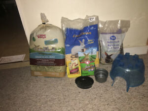 Like new Rabbit cage, food and accessories.